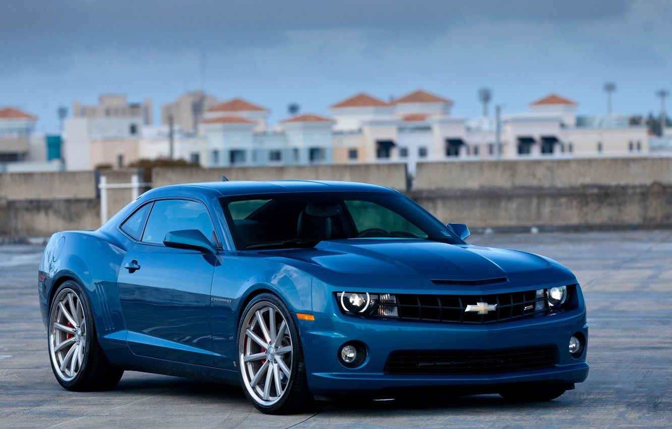 Photo wallpaper roof, the sky, clouds, blue, city, the city, building, front view, chevrolet, blue, buildings, camaro …