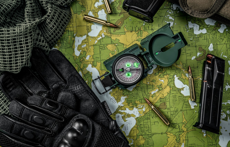 Photo wallpaper map, fabric, gloves, bullets, cartridges, compass