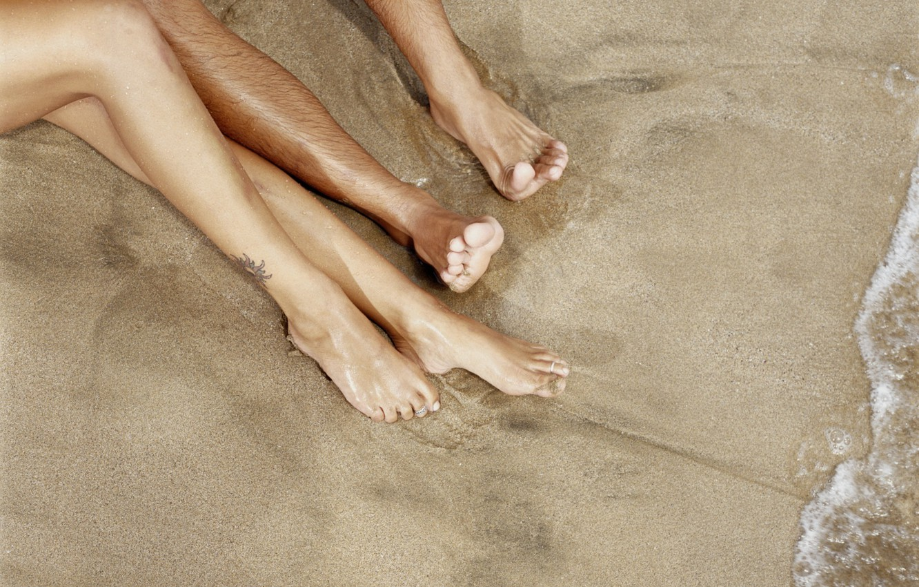 Photo wallpaper sand, water, shore, two pairs of legs