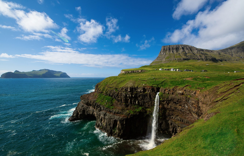 Photo wallpaper the sky, clouds, mountains, rocks, waterfall, village, on the edge, The Atlantic ocean, Faroe Islands, …