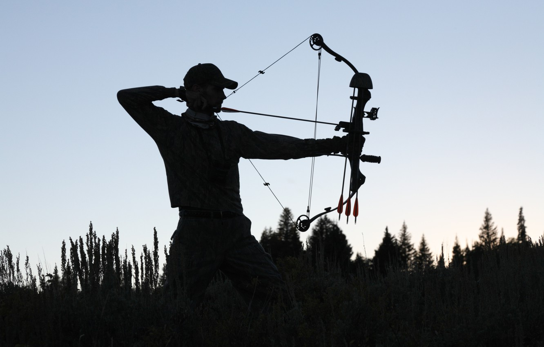 Photo wallpaper sunset, man, shadows, archery, compound bow