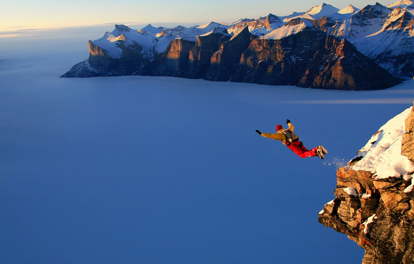 Photo wallpaper snow, mountains, jump, skydiver, height.