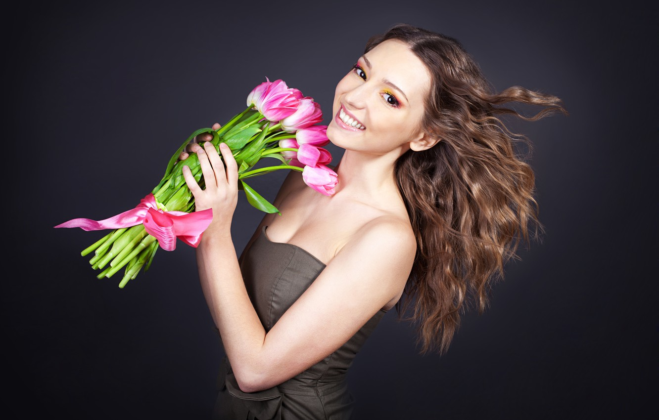 Photo wallpaper girl, joy, flowers, smile, background, mood, bouquet, makeup, dress, hairstyle, tulips, brown hair, ribbon