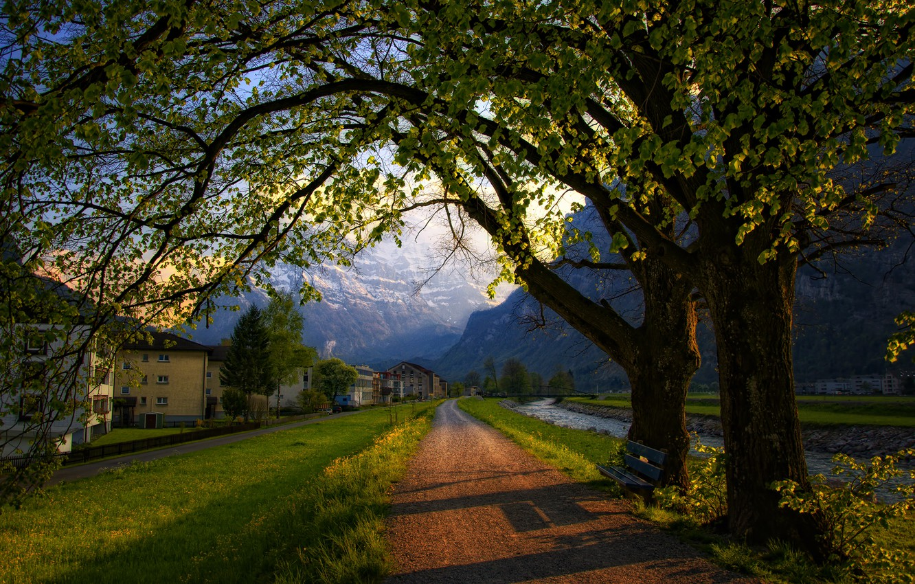 Photo wallpaper road, trees, mountains, bench, the city, home, spring, the evening, Switzerland, Alps, shop, Switzerland, Alps
