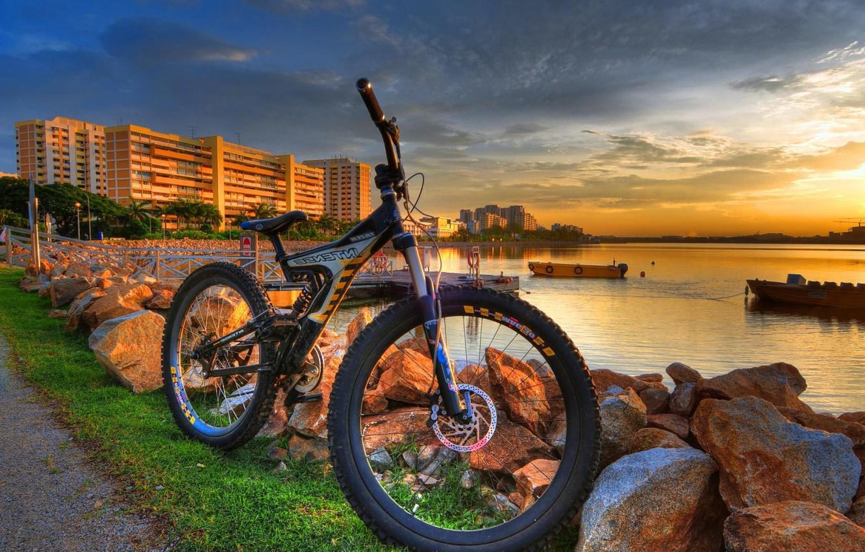 Photo wallpaper water, bike, house, stones, shore, the evening