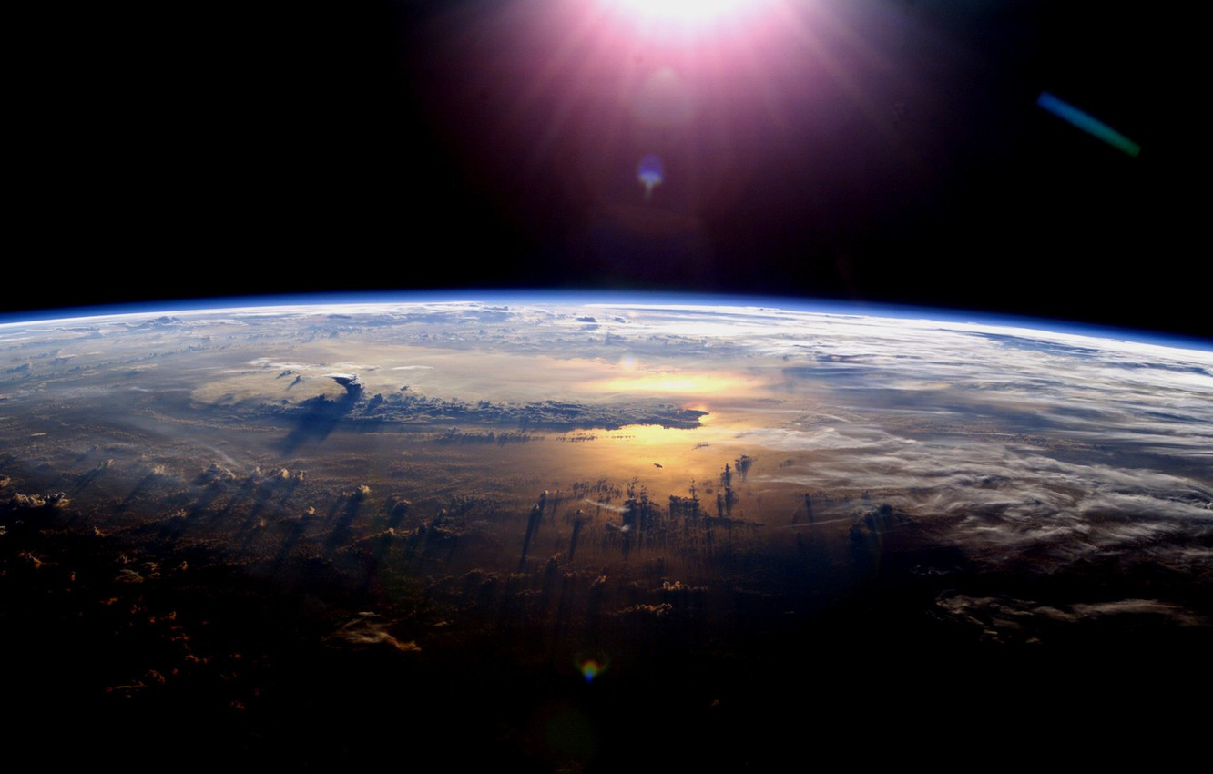 Photo wallpaper space, clouds, light, planet, the atmosphere
