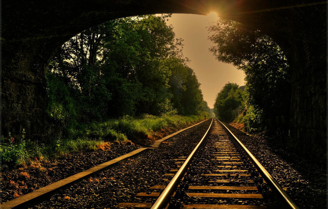 Photo wallpaper road, the sun, rays, trees, rails, arch, iron, tray, sleepers, bridge, gravel