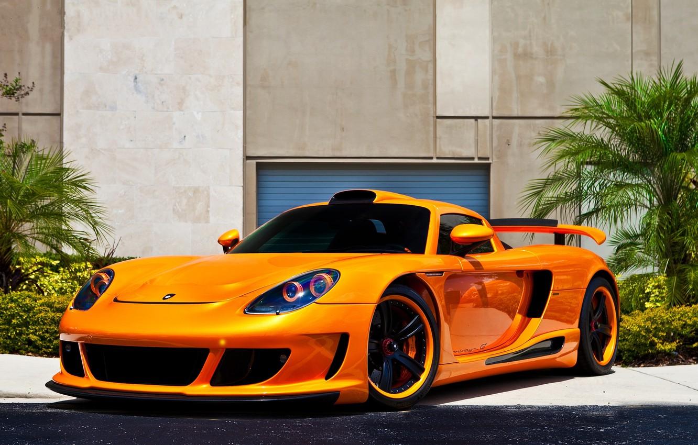 Photo wallpaper flowers, orange, black, wall, porsche, drives, Porsche, front view, orange, carrera gt, Carrera GT