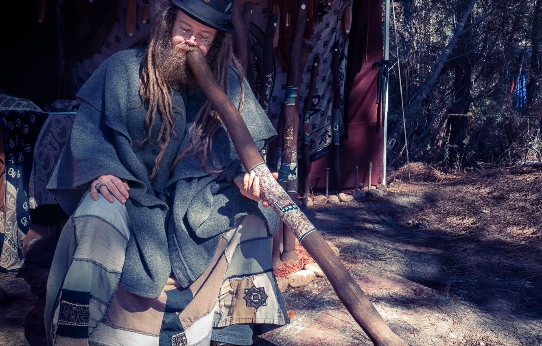 Photo wallpaper man, hat, beard, dreadlocks, wind instrument, didgeridoo