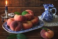 Picture still life, peaches, candle, pitcher, leaves