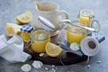 Picture lemon cream, meringue, jars, lemons, dessert
