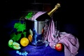 Picture flowers, lemon, glasses, bucket, leaves, the dark background, fruit, tablecloth, apples, champagne