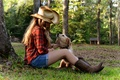 Picture hat, dog, sitting, tree, house, girl, grass, sunset