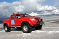 Picture red, jeep, snow, the sky, SUV, clouds, Arctic Trucks Toyota Hilux