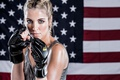 Picture blonde, American flag, martial arts pose