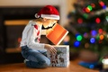 Picture child, holiday, box, gift, tree, lights, bokeh, new year, boy