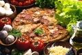 Picture tomatoes, oil, salad, pizza, cheese, ham, garlic, mushrooms