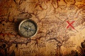 Picture a treasure hunt, compass, old map, where the treasure, place