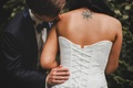 Picture the bride, corset, back, ring, the groom, tattoo, kiss, dress