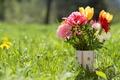 Picture mug, grass, tulips, gerbera, bouquet