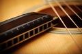 Picture guitar, strings, harmonica, acoustics, macro.